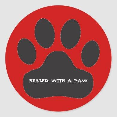 Black Paw Print on Red Background Classic Round Sticker